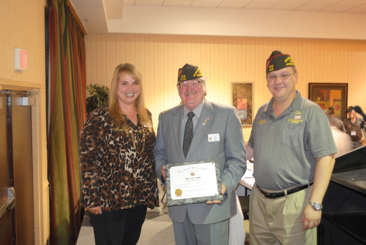Harry Croyle (c) receiving award for serving as Chairman of Veterans Service Committee. Marlene  Khaireddine (1) VFW Service Office Administrative Assistant, Commander Matt David (r).