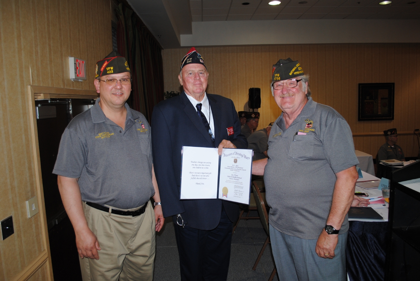 "VFW Smart/Maher VFW National Citizenship Education Teacher Award Middle School Level presented to Jan Flynn (c.) by Matt David (l.) and Harry ""Les"" Croyle (r.)"