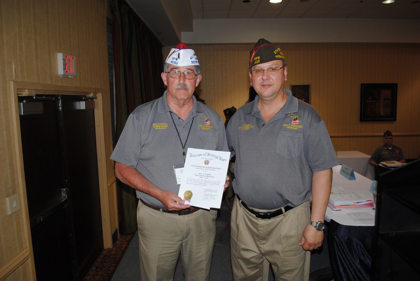 Outstanding Participation certificate presented to John Griffith (r.) for Youth Activities Program by Cmdr. Matt David (l.)