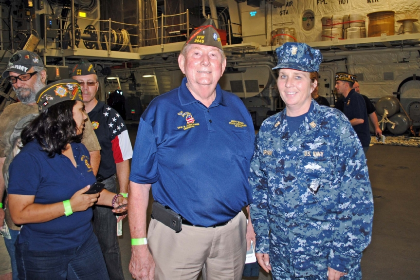 Commander and a Master Chief Petty Officer (E-9)