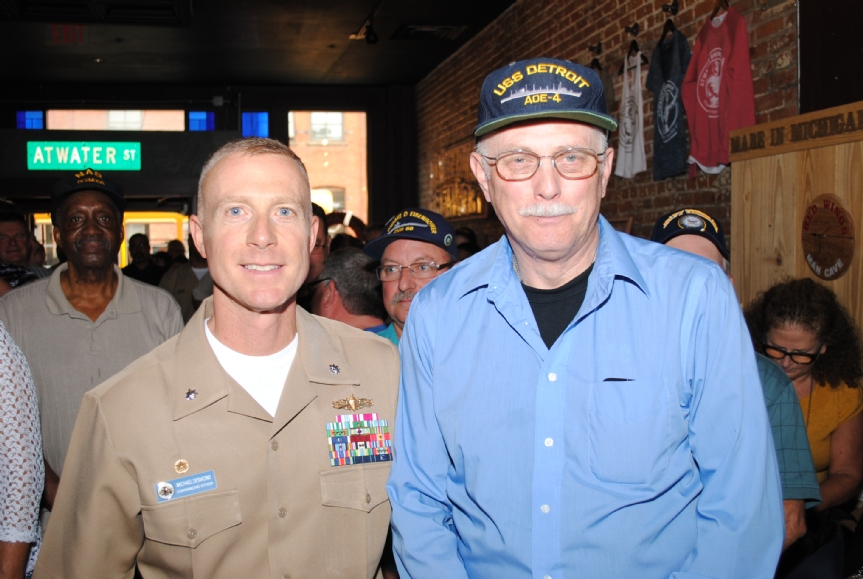 Commander Desmond and a crewmember from the last ship named after Detroit